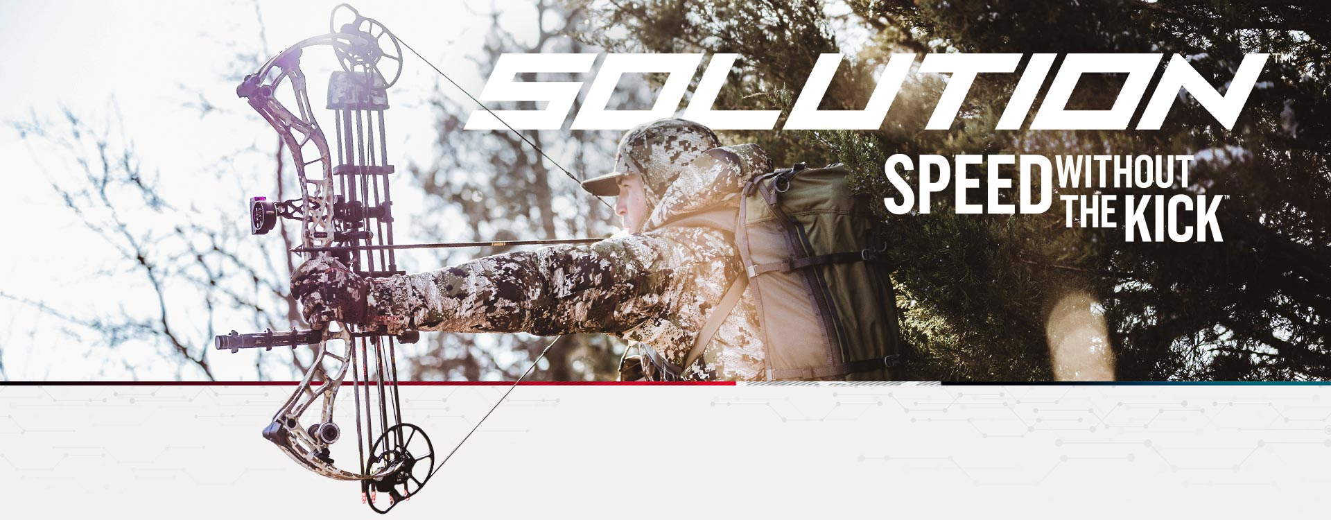 Bow hunter wearing camo clothes shooting a Bowtech Solution archery compound bow