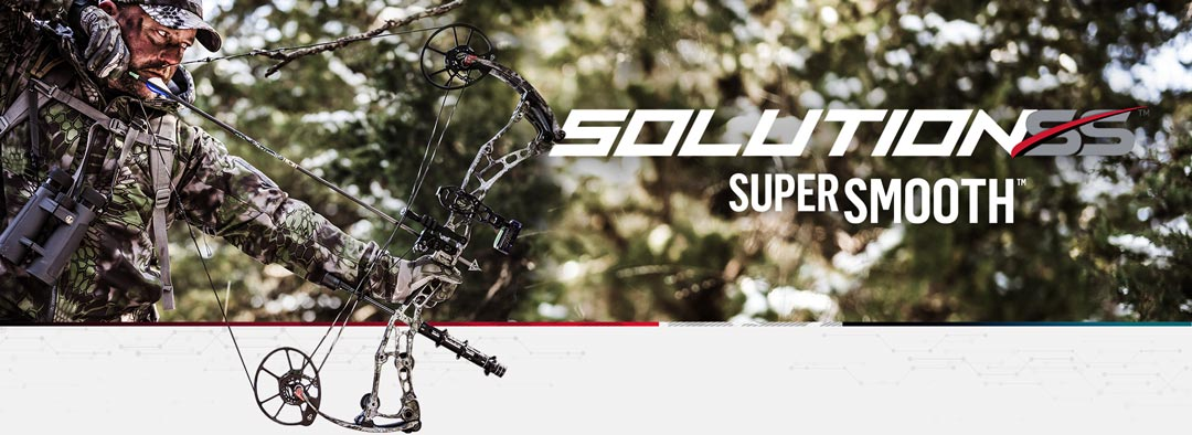 Bow hunter wearing camo clothes shooting a Bowtech Solution SS archery compound bow
